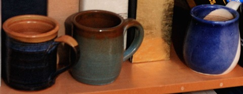 Three past-favorite coffee mugs hiding from the hammer