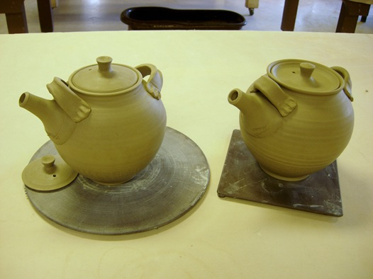 Teapots 3 and 4 with spouts and handle lugs